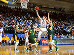 BROOKINGS, SD - DECEMBER 28:  Mike Daum #24 from South Dakota State takes the ball to the basket against North Dakota State during their game Wednesday night at Frost Arena in Brookings. (Dave Eggen/Inertia)
