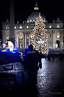 Italian police stand guard  in St. Peter's square.Christmas tree in St. Peter square at the Vatican.8 december 2017