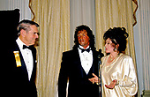 Jackie Stallone, right, mother of American actor, director, screenwriter, and producer Sylvester Stallone, center, makes remarks as her son is honored by the Washington, DC Touchdown Club in Washington, DC on January 23, 1988.  At left is former Washington Redskins head coach George Allen.<br /> Credit: Arnie Sachs / CNP