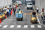 Workers drive turret trucks at the new Tokyo Metropolitan Central Wholesale Market which opened in Toyosu on October 11, 2018, Tokyo, Japan. The new fish market replaces the famous Tsukiji Fish Market which closed for the last time on Saturday 6th October. The move to Toyosu was delayed for almost 2 years because of fears over toxins found in water below the new market. (Photo by Rodrigo Reyes Marin/AFLO)