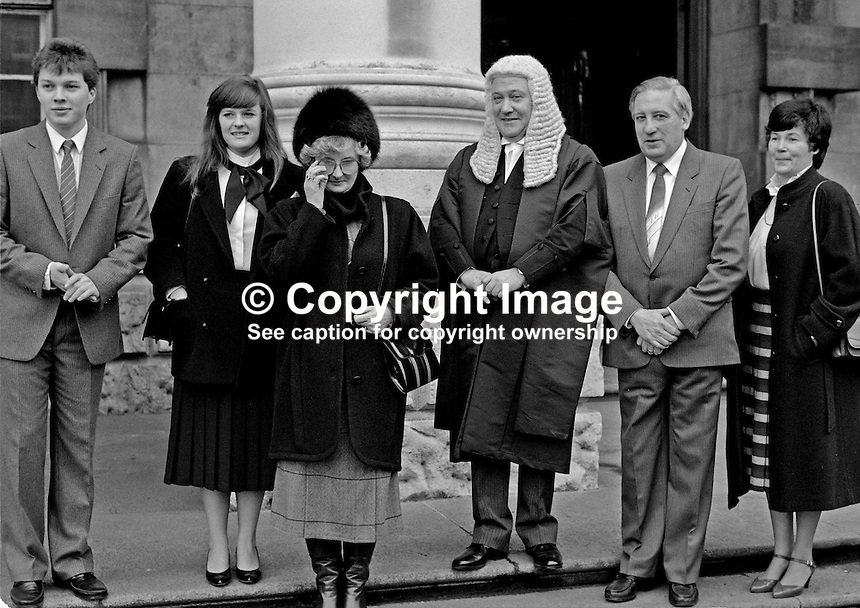 James Brady, QC, barrister, N Ireland, UK, pictured at Belfast High Court on the occasion he took silk. He is with family and friends. 19850005JB2.<br /> <br /> Copyright Image from Victor Patterson, 54 Dorchester Park, Belfast, UK, BT9 6RJ<br /> <br /> t1: +44 28 9066 1296 (from Rep of Ireland 048 9066 1296)<br /> t2: +44 28 9002 2446 (from Rep of Ireland 048 9002 2446)<br /> m: +44 7802 353836<br /> <br /> e1: victorpatterson@me.com<br /> e2: victorpatterson@gmail.com<br /> <br /> The use of my copyright images is subject to my Terms &amp; Conditions.<br /> <br /> It is IMPORTANT that you familiarise yourself with them. They are available on my website at www.victorpatterson.com.<br /> <br /> None of my copyright images may be used on a website unless they are visibly watermarked, i.e. &copy; Victor Patterson within the body of the visible image. Metadata denoting my copyright must NOT be deleted. <br /> <br /> Web use is extra at currently recommended NUJ rates.