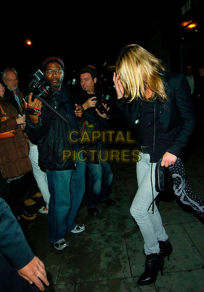 "KATE MOSS.Attends the gala screening of ""Control"", Odeon Covent Garden, London, England, October 2nd 2007..full length grey skinny jeans black jacket ankle boots.CAP/CAN.©Can Nguyen/Capital Pictures"
