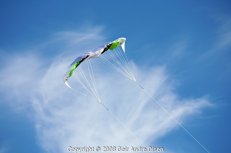 Kite flying high in the blue sky over Oslo, Norway