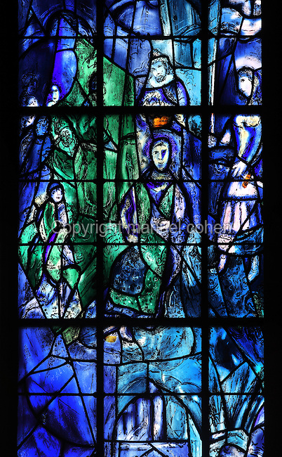 Coronation of King Charles VII of France with Saint Joan of Arc on the right, stained glass window, 1974, by Marc Chagall, 1887-1985, with the studio of Jacques Simon, in the axial chapel of the apse of the Cathedrale Notre-Dame de Reims or Reims Cathedral, Reims, Champagne-Ardenne, France. The cathedral was built 1211-75 in French Gothic style with work continuing into the 14th century, and was listed as a UNESCO World Heritage Site in 1991. Picture by Manuel Cohen