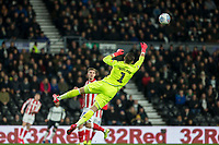 31st January 2020; Pride Park, Derby, East Midlands; English Championship Football, Derby County versus Stoke City; Stoke City Goalkeeper Jack Butland jumps in the air to clear the ball from the goal - Strictly Editorial Use Only. No use with unauthorized audio, video, data, fixture lists, club/league logos or 'live' services. Online in-match use limited to 120 images, no video emulation. No use in betting, games or single club/league/player publications