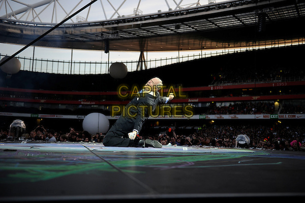 Muse.Muse perform live in concert, Emirates Stadium, London, England, UK,.25th May 2013..music gig on stage performance performing full length suit kneeling .CAP/MAR.© Martin Harris/Capital Pictures.