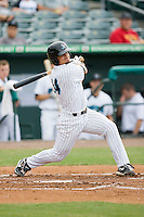 Jake Smolinski #14 of the Jupiter Hammerheads follows through on his swing against the Charlotte Stone Crabs at Roger Dean Stadium June 15, 2010, in Jupiter, Florida.  Photo by Brian Westerholt /  Seam Images
