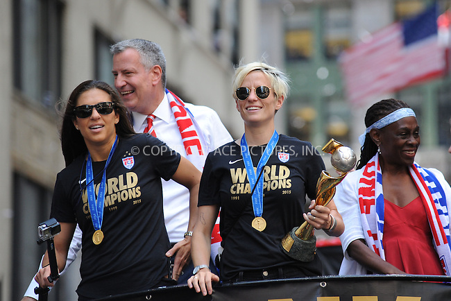 WWW.ACEPIXS.COM<br /> July 10, 2015 New York City<br /> <br /> Soccer player Carli Lloyd, Mayor Bill de Blasio, soccer player Megan Rapinoe and Chirlane McCray aboard a float in the New York City Ticker Tape Parade for World Cup Champions U.S.A. Women's Soccer National Team on July 10, 2015 in New York City.<br /> <br /> <br /> Credit: Kristin Callahan/ACE Pictures<br /> <br /> Tel: 646 769 0430<br /> e-mail: info@acepixs.com<br /> web: http://www.acepixs.com