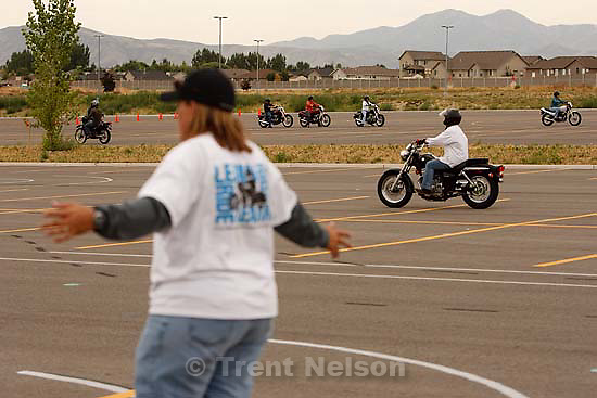 West Jordan - Riders on the course during a motorcycle basic rider course put on by Motorcycle Rider Training at Salt Lake Community College's Jordan campus Saturday, August 29 2009. Instructor at left is Michelle Havranek..