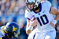 Morgantown, WV - NOV 10, 2018: TCU Horned Frogs quarterback Michael Collins (10) evades a tackle during first half action of game between West Virginia and TCU at Mountaineer Field at Milan Puskar Stadium Morgantown, West Virginia. (Photo by Phil Peters/Media Images International)