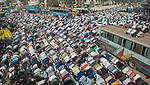 Pictured: Muslims pray in the streets of Tongi, Bangladesh as part of Bishwa Ijteman.<br /> <br /> Millions of praying Muslims stopped traffic today as they took part in an annual religious festival.  They prayed together for ten minutes as traffic came to a standstill in the town of Tongi, Bangladesh.<br /> <br /> The worshippers all faced in one direction, towards Mecca - the holiest of Muslim cities.  SEE OUR COPY FOR DETAILS.<br /> <br /> Please byline: Zakirul Mazed/Solent News<br /> <br /> © Zakirul Mazed/Solent News & Photo Agency<br /> UK +44 (0) 2380 458800