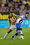 Nederland , Arnhem , 29 maart 2014<br /> Eredivisie<br /> seizoen 2013-2014<br /> Vitesse - Heerenveen<br /> Patrick van Aanholt (l) in duel met Heerenveen spits Bilal Basacikoglu (r)