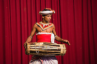 Kandy, man drumming at a traditional Kandyan dance tourist show at the Kandy Arts Assication Hall, Sri Lanka, Asia. This is a photo of a man drumming at a traditional Kandyan dance tourist show at the Kandy Arts Assication Hall, Sri Lanka, Asia.