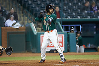 J.C. Millan (14) of the Greensboro Grasshoppers at bat against the Augusta GreenJackets at First National Bank Field on April 10, 2018 in Greensboro, North Carolina.  The GreenJackets defeated the Grasshoppers 5-0.  (Brian Westerholt/Four Seam Images)