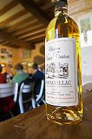 A bottle of sweet white Chateau Vieux Touron Monbazillac that goes well with truffles Truffiere de la Bergerie (Truffière) truffles farm Ste Foy de Longas Dordogne France