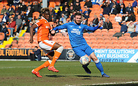 Blackpool's Armand Gnanduillet vies for possession with Peterborough United's Jason Naismith<br /> <br /> Photographer Kevin Barnes/CameraSport<br /> <br /> The EFL Sky Bet League One - Blackpool v Peterborough United - Saturday 13th April 2019 - Bloomfield Road - Blackpool<br /> <br /> World Copyright &copy; 2019 CameraSport. All rights reserved. 43 Linden Ave. Countesthorpe. Leicester. England. LE8 5PG - Tel: +44 (0) 116 277 4147 - admin@camerasport.com - www.camerasport.com