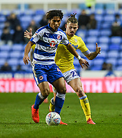 Leeds United's Kalvin Phillips (right) vies for possession with Reading's Danny Loader (left) <br /> <br /> Photographer David Horton/CameraSport<br /> <br /> The EFL Sky Bet Championship - Reading v Leeds United - Tuesday 12th March 2019 - Madejski Stadium - Reading<br /> <br /> World Copyright © 2019 CameraSport. All rights reserved. 43 Linden Ave. Countesthorpe. Leicester. England. LE8 5PG - Tel: +44 (0) 116 277 4147 - admin@camerasport.com - www.camerasport.com