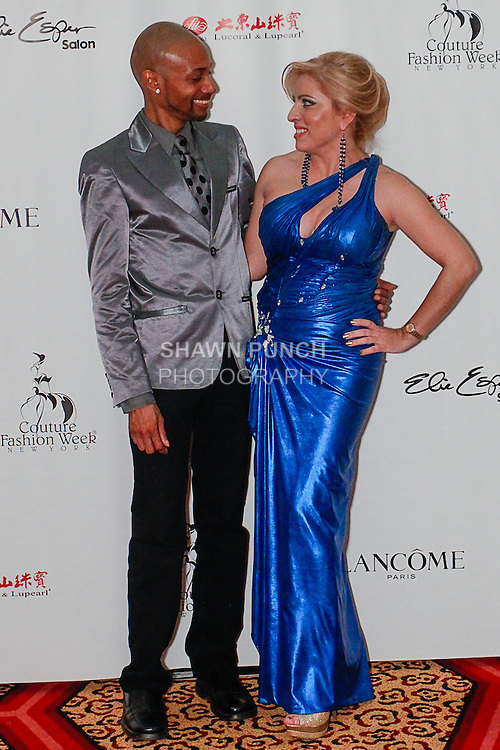 Fashion designer Tyrell Mason and singer Vanessa Cruz pose on the red carpet after the Tyrell Collection and Lourdes Atencio Fall 2013 Couture collection fashion show, during Couture Fashion Week New York Fall 2013, on February 15, 2013.