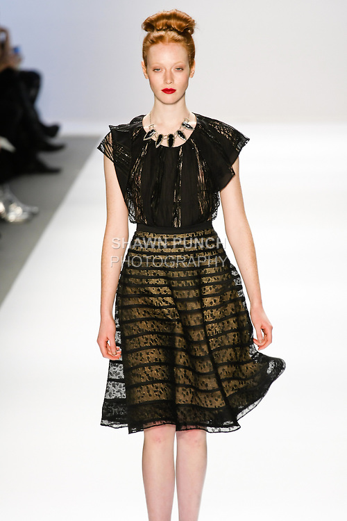 Chantal Stafford-Abbott walks the runway in a Luca Luca Fall 2011 outfit, designed by Raul Melgoza, during Mercedez-Benz Fashion Week, February 10, 2011
