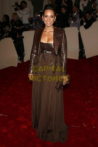 "ALICIA KEYS .attending the Metropolitan Museum of Art's Costume Institute Gala ""Alexander McQueen: Savage Beauty"" held at the Metropolitan Museum of Art, New York, NY, USA, May 2nd 2011..full length leather brown croc jacket  dress clutch bag long maxi .CAP/LNC.©TOM/LNC/Capital Pictures."