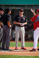 Rutgers Scarlet Knights coach Joe Litterio (9) during the lineup exchange before a game against the Indiana Hoosiers on February 23, 2018 at North Charlotte Regional Park in Port Charlotte, Florida.  Indiana defeated Rutgers 7-6.  (Mike Janes/Four Seam Images)