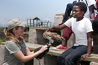Lindy Thompson dispelling bad luck myths about Owls, as a student of the  Mehlokazulu High School Enviro Club touches a barn owl during their Nikela sponsored visit. .October 2010..African Bird of Prey Sanctuary..Kwazulu-Natal, South Africa.