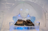 Sweden, SWE, Kiruna, 2006-Apr-12: A bed covered with reindeer skins in a bedroom of the Jukkasjarvi icehotel .