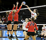 SIOUX FALLS, SD - DECEMBER 8:  Aleah Stauffer #15 and Haley Kindall #6 from Wheeling Jesuit block a kill attempt by Aly Schneider #12 from Lewis during their quarterfinal match at the 2016 Women's Division II Volleyball Championship at the Sanford Pentagon in Sioux Falls, SD. (Photo by Dave Eggen/Inertia)