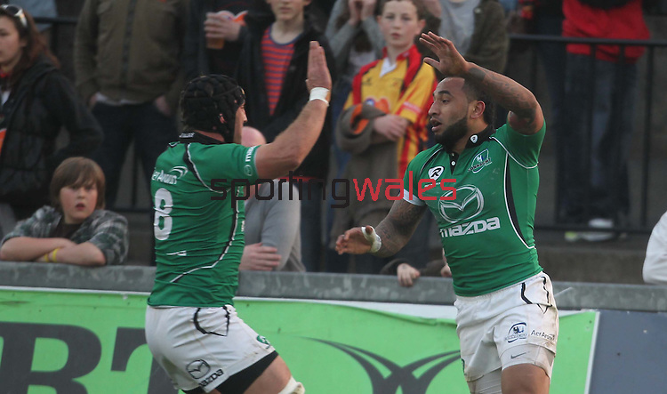 Rabo Direct Pro 12.Fetu'u Vainikolo celebrates with John Muldoon after diving over in the corner to score the first try of the match for Connacht..Newport Gwent Dragons v Connacht.30.03.12.©Steve Pope
