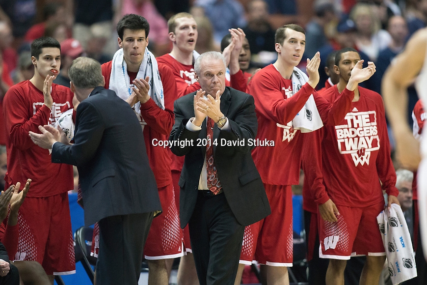 Wisconsin Badgers Head Coach Bo Ryan and his team cheer during  the Western Regional Final NCAA college basketball tournament game against the Arizona Wildcats Saturday, March 29, 2014 in Anaheim, California. The Badgers won 64-63 (OT). (Photo by David Stluka)