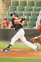Michael Marjama (12) of the Kannapolis Intimidators follows through on his swing against the Lakewood BlueClaws at CMC-Northeast Stadium on August 14, 2013 in Kannapolis, North Carolina.  The Intimidators defeated the BlueClaws 10-2.  (Brian Westerholt/Four Seam Images)