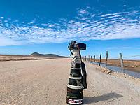 Canon 1dx Mark II bed with 500 mm lens in the middle of the landscape and sonorous desert, on a sunny day.<br /> <br /> blue sky, dirt road, clouds, horizon, wooden fence, fence of puas, in the middle of the road, aquaculture farms, photography, photo, travel photography, adventure photography, landscape photography, outdoor, no people,<br /> <br /> Cama canon  1dx Mark II con lente 500 milímetros en medio del  paisaje y desierto de sonora, en un dia soleado. <br /> <br /> cielo azul, camino de terracería, nubes, horizonte, cerco de madera, cerco de puas, en medio del camino, granjas acuicola, fotografia, foto, fotografia de viaje, fotografia de aventura, fotografia de paisaje, outdoor, no people,