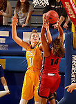 BROOKINGS, SD - NOVEMBER 12:  Clarissa Ober #21 from South Dakota State University battles for the rebound with Micah Jones #14 from Southern Illinois Edwardsville at Frost Arena November 13, 2016 in Brookings, South Dakota. (Photo by Dave Eggen/Inertia)