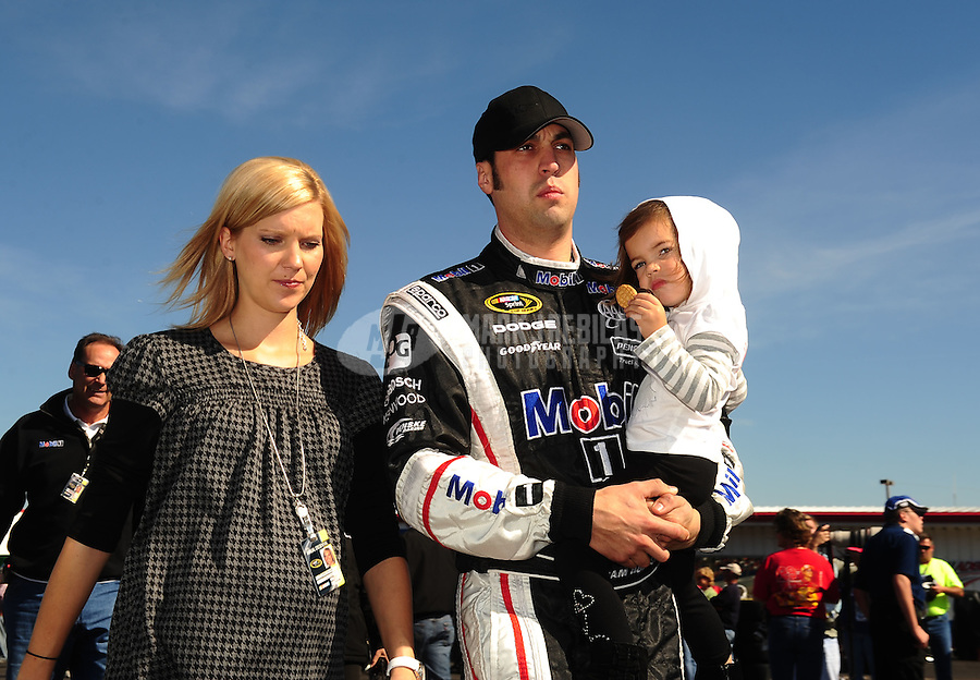 Oct. 30, 2010; Talladega, AL, USA; NASCAR Sprint Cup Series driver Sam Hornish Jr (center) walks with wife Crystal Hornish as he holds his daughter Addison Hornish during qualifying for the Amp Energy 500 at the Talladega Superspeedway. Mandatory Credit: Mark J. Rebilas-