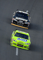 Oct 5, 2008; Talladega, AL, USA; NASCAR Sprint Cup Series driver Paul Menard (15) leads teammate Aric Almirola (8) during the Amp Energy 500 at the Talladega Superspeedway. Mandatory Credit: Mark J. Rebilas-