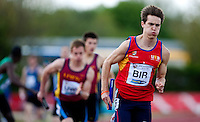 03 MAY 2010 - BEDFORD, GBR - The University of Birmingham runner powers away from the changeover as his rivals await their runners in the mens 4x400m relay final at the BUCS Outdoor Athletics Championships (PHOTO (C) NIGEL FARROW)