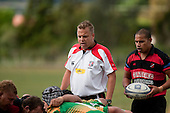 Referee Nigel Bradley watches the two frontrows as they engage at scrumtime. Counties Manukau Premier Club Rugby Game of the Week between Drury & Papakura, played at Drury Domain on Saturday Aprill 11th, 2009..Drury won 35 - 3 after leading 15 - 5 at halftime.