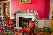 "The 2017 White House Christmas decorations, with the theme ""Time-Honored Traditions,"" which were personally selected by first lady Melania Trump, are previewed for the press in Washington, DC on Monday, November 27, 2017.  Pictured are red bows and peppermints over the mantel in the Red Room.<br /> Credit: Ron Sachs / CNP"