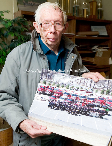 SOUTHBURY, CT- 29 MARCH 07- 032907JT08- <br /> Everett Parker Hopkins, 83, holds a portrait he shot of Southbury firefighters and apparatus for the department's 75th anniversary.<br /> Josalee Thrift Republican-American