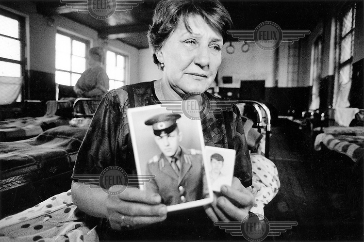 © Heidi Bradner / Panos Pictures..Chechnya, RUSSIA..Lydia Andreevna, from Novo-Cheboksary in the Urals, in the Chechen schoolhouse where she has lived for four months. She abandoned her job and home to come and search for her son Vallodiod, a conscript missing in action, but receives no help from the Russian government.