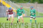 Ballyduff's Eric O'Connor gets away from Causeway's Jason Leahy  at Austin Stack park, Tralee on Saturday.