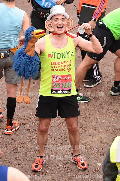 Tony Audenshaw finishes the 2015 London Marathon, The Mall, London 26/04/2015 Picture by: Steve Vas / Featureflash