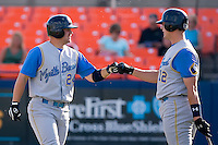 Eric Campbell (24) of the Myrtle Beach Pelicans fist bumps with teammate Tyler Flowers (12) following his solo home run in the top of the 1st inning at Harry Grove Stadium in Frederick, MD, Monday July 14, 2008. (Photo by Brian Westerholt / Four Seam Images)