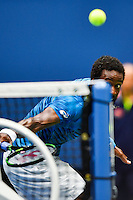 NEW YORK, USA - SEPT 09, Gael Monfils of France returns a shot against  Novak Djokovic of Serbia during their Men's Singles Semifinal Match of the 2016 US Open at the USTA Billie Jean King National Tennis Center on September 9, 2016 in New York.  photo by VIEWpress
