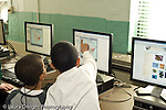 Education Elementary school Grade 2 science computer lab male students at work horizontal