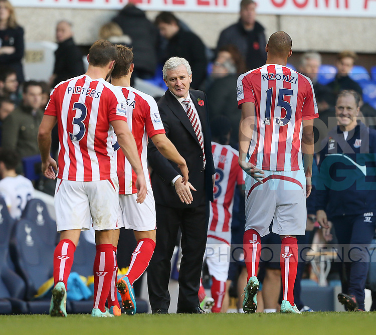 Stoke's Mark Hughes celebrates at the final whistle<br /> <br /> - Barclays Premier League - Tottenham Hotspur vs Stoke City- White Hart Lane - London - England - 9th November 2014  - Picture David Klein/Sportimage