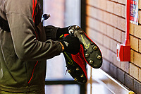 Pictured: Calaum Jahraldo-Martin adjusts the studs on his football boots before training. Thursday 18 January 2018<br /> Re: Players and staff of Newport County Football Club prepare at Newport Stadium, for their FA Cup game against Tottenham Hotspur in Wales, UK