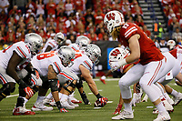 Ohio State Buckeyes offensive lineman Billy Price (54) lines up to snap the ball across from the Wisconsin Badgers defense during the second quarter of the Big Ten championship football game at Lucas Oil Stadium in Indianapolis on Dec. 2, 2017. [Adam Cairns / Dispatch]