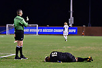 GREENSBORO, NC - DECEMBER 02: Jason Gonzalez #15 of North Park College receives a yellow card after colliding with a Messiah College player during the Division III Men's Soccer Championship held at UNC Greensboro Soccer Stadium on December 2, 2017 in Greensboro, North Carolina. Messiah College defeated North Park University 2-1 to win the national title. (Photo by Grant Halverson/NCAA Photos via Getty Images)