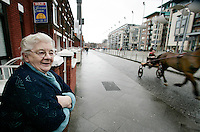 Smithfield resident Joan Mac Convey watches the horses passing her home.<br />